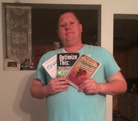 Tyson Waldo displaying 3 of Rob's books